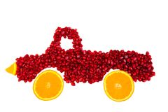 Seeds of pomegranate is shape of lorry isolated. Healthy food concept. stock image