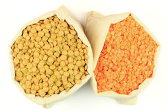 Seeds red and green Lentils in fabric bags. Royalty Free Stock Photography