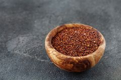 Seeds of red quinoa in wooden bow copy space Stock Photos