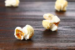 Seeds of salted popcorn on a wooden table. Seeds of salted popcorn on a wooden table Royalty Free Stock Photography