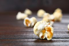 Seeds of salted popcorn on a wooden table. Seeds of salted popcorn on a wooden table Royalty Free Stock Photo