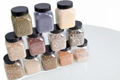 Seeds and spices in glass jars Royalty Free Stock Photography