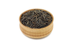 Seeds of wild rice in a wooden dish Royalty Free Stock Photography