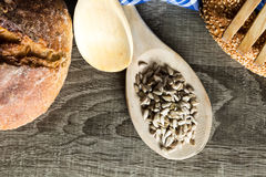 Seeds in Wooden Spoon Spread on Wood Background with Table Cloth Royalty Free Stock Photography