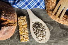 Seeds in Wooden Spoon Spread on Wood Background with Table Cloth Stock Images