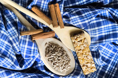 Seeds in Wooden Spoon Spread on Wood Background with Table Cloth Royalty Free Stock Photos