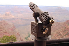 Seeing the Grand Canyon. There are many ways to see the Grand Canyon's beauty.  Telescopes stationed across the South Rim allow a bird's eye view down into the Stock Image