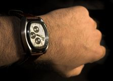 Seeing hours in a Expensive watch. Picture of a hand with a expensive watch stock image