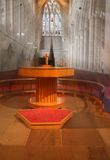 Seeing the light. Shafts of Light fall on Alter with pews and font in background stock photo