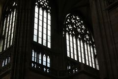 Seeing the light, shafts of light stream through stained glass window and onto cross below.  Royalty Free Stock Photos