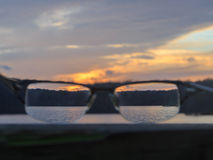 Seeing nature through glasses. Beautiful landscape during sunset with eye glasses Royalty Free Stock Image