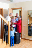 Seeing off the relatives. Happy family seeing off the kinfolks to vacations Royalty Free Stock Images