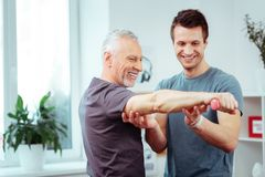Joyful nice men being in a positive mood. Seeing the result. Joyful nice men being in a positive mood while seeing the result of their training royalty free stock images