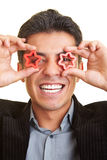 Seeing stars. Happy man holding two stars in front of his eyes Royalty Free Stock Image