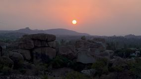 Seeing the sunset in India. Hampi Karnataka India march 25 2019: Sunset point Hemakuta stock footage