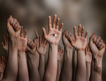 Seeing the truth - symbolic. Image with hands of different people Stock Images