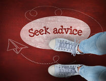 Seek advice against desk Stock Image