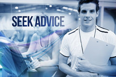 Seek advice against spinning class instructor holding clipboard Stock Images