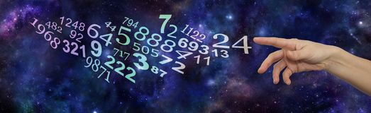 Seek the advice of a Numerology Expert. Female hand pointing at a flow of random numbers on a dark blue deep space starry night backgroundn stock photo