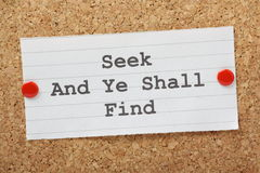 Seek and Find. The phrase Seek and Ye Shall Find typed on a piece of paper and pinned to a cork notice board Royalty Free Stock Image