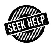 Seek Help rubber stamp. Grunge design with dust scratches. Effects can be easily removed for a clean, crisp look. Color is easily changed Stock Photography