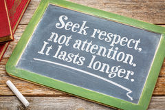 Seek respect, not attention - blackboard sign. Seek respect, not attention. It last s longer. Motivational text on a slate blackboard with a white chalk and a Royalty Free Stock Images
