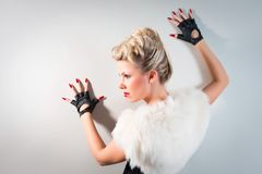 Seek woman wearing black gloves Royalty Free Stock Images