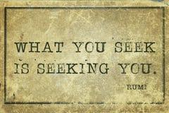 Seek you Rumi. What you seek is seeking you  - ancient Persian poet and philosopher Rumi quote printed on grunge vintage cardboard Royalty Free Stock Photo