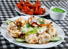 Seekh kebab with salad and tandoori fish Royalty Free Stock Photography