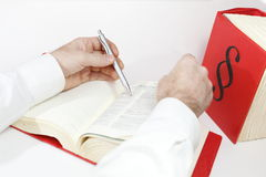 Seeking. In law book with hands, books in background Stock Photography