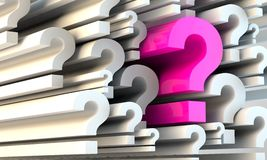 Seeking an answer. Conceptual image of a question among lots of question marks Stock Photo