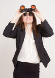 Seeking a career. Portrait of a gorgeous young businesswoman using binoculars Stock Photography