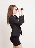 Seeking a career. Portrait of a gorgeous young businesswoman using binoculars Stock Images