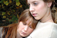 Seeking comfort. Two friends comforting each other in difficult times royalty free stock images