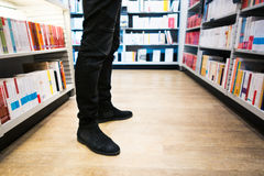 Seeking knowledge. Low section of a man in a library Stock Image