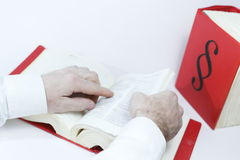 Seeking in law book. With hands, books in background stock photography