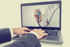 Seeking online medical help Stock Photography