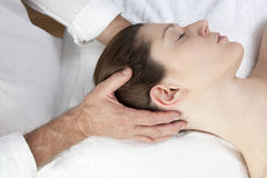 Seeking for suppleness in shoulders. Massage for neck stress relief Stock Photography
