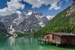 Seekofel and lake Braies (Pragser Wildsee) in june royalty free stock photography