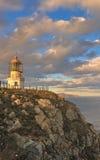 Seelandschaft mit einem Leuchtturm. Lizenzfreies Stockfoto