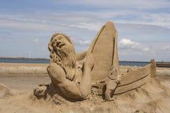 Seemann im Sand Stockfoto