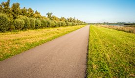 Seemingly endless country road in a Dutch polder Stock Image