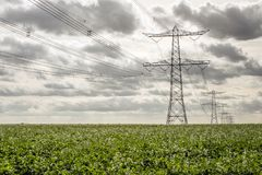 Free Seemingly Endless Row Of Power Pylons Royalty Free Stock Images - 101999039
