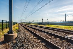 Train tracks on concrete sleepers and basalt gravel in the Nethe. Seeminly endless train tracks on concrete sleepers and basalt gravel in the Netherlands. The royalty free stock photography
