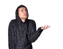 It seems cold & raining. A teenager wondering if its raining or not while feeling cold Stock Photos
