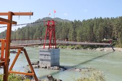 The bridge across the fast current of the river Katun royalty free stock photo