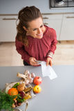 Seen from above, woman smiling with fall fruits and vegetables Stock Images