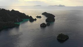 Aerial footage of sunset and Limestone Islands in Raja Ampat stock video footage