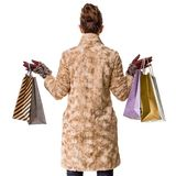 Seen from behind modern shopper in winter coat on white Stock Photos