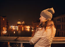 Seen from behind, woman on bridge looking on Grand canal Royalty Free Stock Images